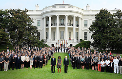 U.S. President Barack Obama, first lady Michelle Obama , Vice President Joseph Biden and White House staff observe a moment of silence to mark the 13th anniversary of the 9/11 attacks, September 11, 2014 on the South Lawn of the White House in Washington, DC. The nation is commemorating the anniversary of the 2001 attacks which resulted in the deaths of nearly 3,000 people after two hijacked planes crashed into the World Trade Center, one into the Pentagon in Arlington, Virginia and one crash landed in Shanksville, Pennsylvania Photo by Olivier Douliery/ABACAPRESS.COM  | 465745_003 Washington Etats-Unis United States