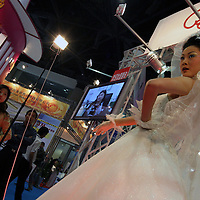 BEIJING, 22. October 2004 : a model shows Western-style bridal wear at the International Beauty Week in Beijing, October 22, 2004, in China. Beauty business is booming in China. Sales in beauty related businesses and products are worth more than 7 billion USD last year.      ..Whereas in Mao Zedong's China, even pigtails were seen as a sign of vanity (and had to be cut off) , nowadays, urban Chinese women seek about every means in order to distinguish themselves from the masses.  This year Beijing will organize the worl'd first beauty pageant for women had had plastic surgery in early December...