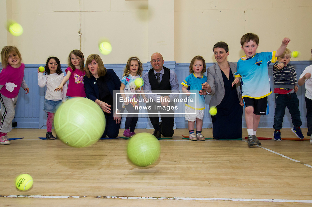 Pictured: Alison Johnstone, Partick Harvie and Maggie Chapman joined in the fun with the children attending the North Merchiston Community Centre.<br /> <br /> Patrick Harvie, Co-Convenor of the Scottish Green Party met children at the Enjoy-a-Ball Holiday camp taking place at the North Merchiston Community Centre ahead of Tuesday's TV debate. Mr Harvie was joined by fellow MSP candidates Andy Wightman, Local Government Spokesperson, Maggie Chapman, Co-convener and Alison Johnston candiate for Lothian to present taxation proposals and answer questions.<br /> <br /> Ger Harley | EEm 29 March 2016
