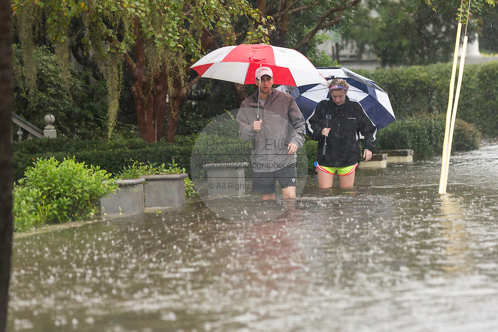 Residents wade through floodwaters in the historic district as Hurricane Joaquin brings heavy rain, flooding and strong winds as it passes offshore October 3, 2015 in Charleston, South Carolina.
