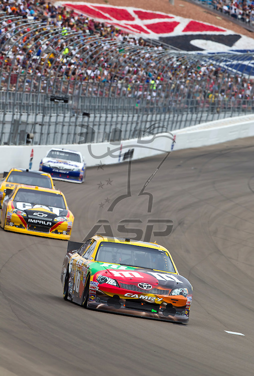 LAS VEGAS, NV - MAR 11, 2012:  Kyle Busch (18) brings his car through the turns during the Kobalt Tools 400 race at the Las Vegas Motor Speedway in Las Vegas, NV.
