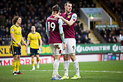 Burnley forward Chris Wood encourages Burnley forward Jay Rodriguez after his ball hit the cross bar during the Premier League match between Burnley and Arsenal at Turf Moor, Burnley, England on 2 February 2020.