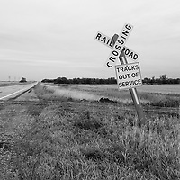 Road sign by disused railroad in Bottineau County USA