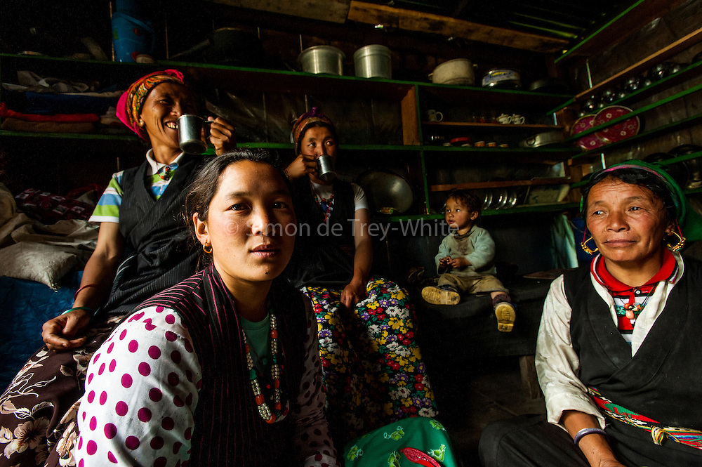 Female Tamang porters in traditional Tibetan dress having tea in a trailside restaurant in the Langtang Valley, Nepal, 27th May 2009. <br /> <br /> According to Dorothea Stumm, a glaciologist at the Nepal-based International Centre for Integrated Mountain Development, a massive hanging glacier cracked when an earthquake struck at 11.56am on the 25th April 2015. The ice formed a cloud that gathered snow and rocks and then funnelled down the mountain, burying Langtang village, and creating an enormous pressurised blast. 400 residents of the village and up to 100 trekkers are believed to have been killed.<br /> <br /> PHOTOGRAPH BY AND COPYRIGHT OF SIMON DE TREY-WHITE<br /> <br /> + 91 98103 99809<br /> email: simon@simondetreywhite.com<br /> photographer in delhi