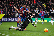 Oscar of Chelsea is felled by Mile Jedinak of Crystal Palace during the Barclays Premier League match between Crystal Palace and Chelsea at Selhurst Park, London, England on 3 January 2016. Photo by Ken Sparks.