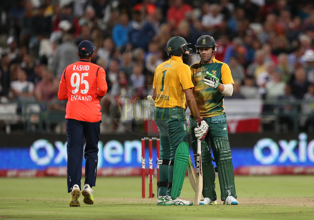 Hashim Amla and AB de Villiers during the First KFC T20 Match between South Africa and England played at Newlands Stadium, Cape Town, South Africa on February 19th 2016