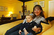 2/4/2002 .Sunday Times Property.Heidi Day and her son Lawson pictured in the master bedroom at Mount Loftus in Kilkenny..Picture Dylan Vaughan