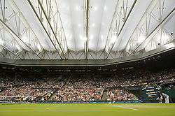 LONDON, ENGLAND - Tuesday, June 28, 2011: Marion Bartoli (FRA) serves under the roof on Centre Court during the Ladies' Singles Quarter-Final match on day eight of the Wimbledon Lawn Tennis Championships at the All England Lawn Tennis and Croquet Club. (Pic by David Rawcliffe/Propaganda)