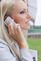 Side view close-up of young businesswoman using mobile phone