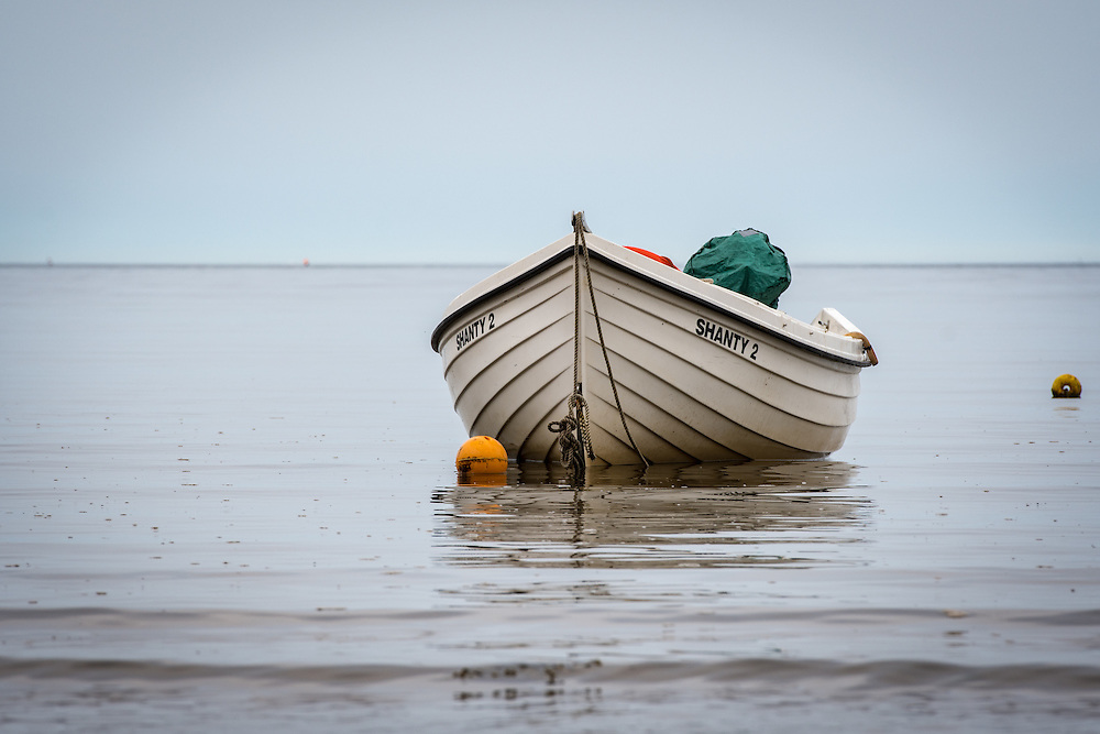 UK, England, Yorkshire - A boat in the water on a beach right outside the small fishing village called Robin Hood's Bay, located on the coast of North Yorkshire, England.