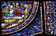 Saint Maximin places the body of Mary Magdalene in a tomb, from the death of Mary, from the Life of Mary Magdalene stained glass window, 13th century, in the nave of Chartres cathedral, Eure-et-Loir, France. Chartres cathedral was built 1194-1250 and is a fine example of Gothic architecture. Most of its windows date from 1205-40 although a few earlier 12th century examples are also intact. It was declared a UNESCO World Heritage Site in 1979. Picture by Manuel Cohen