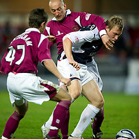 Falkirk v St Johnstone.....05.05.10<br /> Scott Arfield holds off Paul Sheerin<br /> Picture by Graeme Hart.<br /> Copyright Perthshire Picture Agency<br /> Tel: 01738 623350  Mobile: 07990 594431
