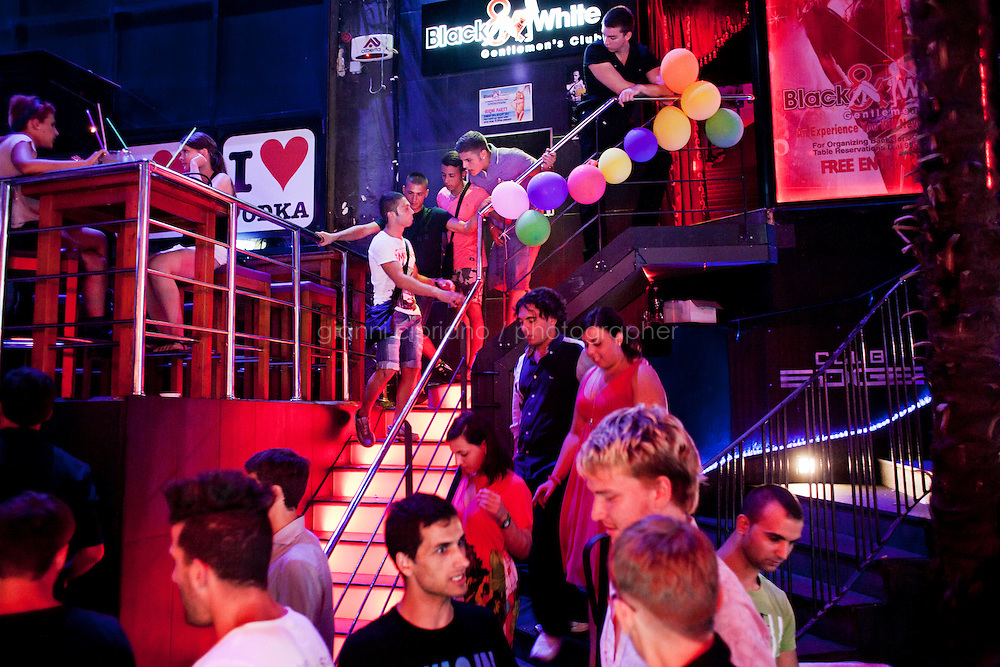Paceville, Malta - 19 August, 2012:  Tourists stand outside a club in Paceville, Malta, on 19 August, 2012. Malta has reached a record in 2011 for inbound tourism with approximately 1.4 million tourists, equivalent to an increase of 5.6% when compared to 2010. According to the Malta Tourism Authority, each year Malta hosts over one million visitors and this accounts for 23% of GDP. Thirty per cent of the Maltese population is directly employed in this fast growing sector.<br /> <br /> Gianni Cipriano for The New York Times
