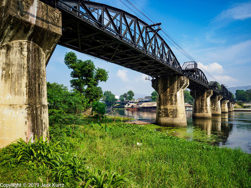 "09 JANUARY 2019 - KANCHANABURI, THAILAND: The ""Bridge On the River Kwai"" in Kanchanaburi. Hundreds of thousands of Asian slave laborers and Allied prisoners of war died in World War II constructing the ""Death Railway"" between Bangkok and Rangoon (now Yangon), Burma (now Myanmar) for the Japanese during World War II.  The bridge is now one of the most famous tourist attractions in Thailand.      PHOTO BY JACK KURTZ"