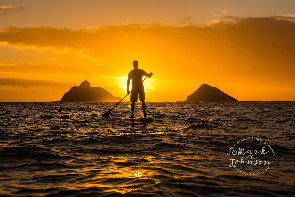 Stand-Up Paddle Boarding at sunrise off the Mokulua Islands, Lanikai, Kailua Bay, Oahu, Hawaii