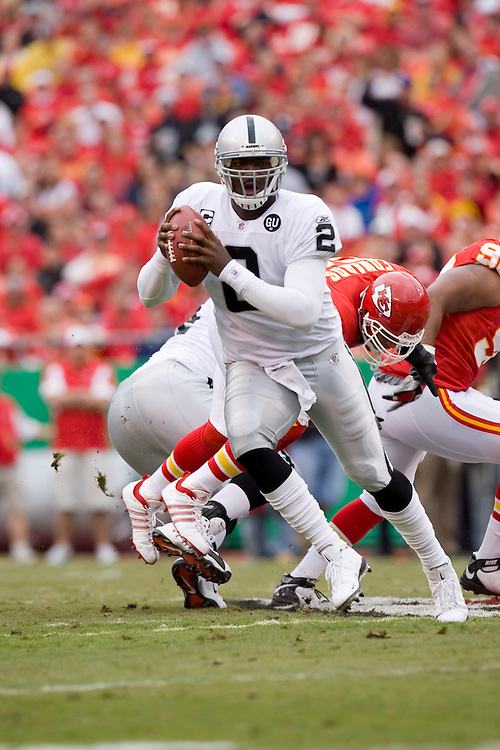 KANSAS CITY, MO - SEPTEMBER 14:   JaMarcus Russell #2 of the Oakland Raiders rolls out to avoid a rush against the Kansas City Chiefs at Arrowhead Stadium on September 14, 2008 in Kansas City, Missouri.  The Raiders defeated the Chiefs 23-8.  (Photo by Wesley Hitt/Getty Images) *** Local Caption *** JaMarcus Russell