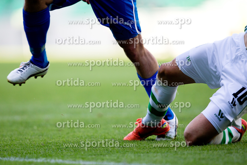 Andraz Sporar of NK Olimpija with sliding tackle on Hans Aage Yndestad of Tromso IL during football match between NK Olimpija Ljubljana and Tromsø IL  (NOR) in 1st Leg of UEFA Europa League 2013 2nd  Qualifying Round, on July 19, 2012 in SRC Stozice, Ljubljana, Slovenia. (Photo by Matic Klansek Velej / Sportida.com)