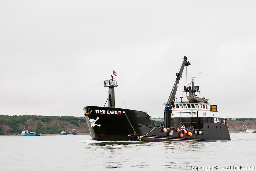 The commercial salmon fishing tender vessel, F/V Time Bandit motors into the Naknek River during the Bristol Bay sockeye salmon fishery, Bristol Bay, Alaska.(of deadliest catch fame)  motors into the Naknek River during the Bristol Bay sockeye salmon fishery, Bristol Bay, Alaska.