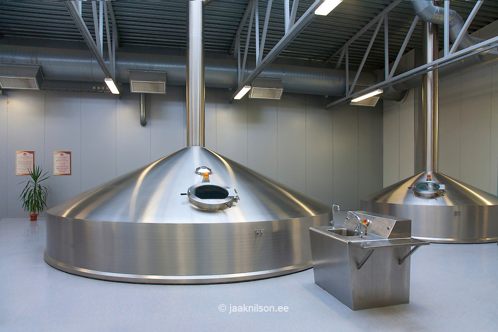 Brewery interior with large stainless steel tanks