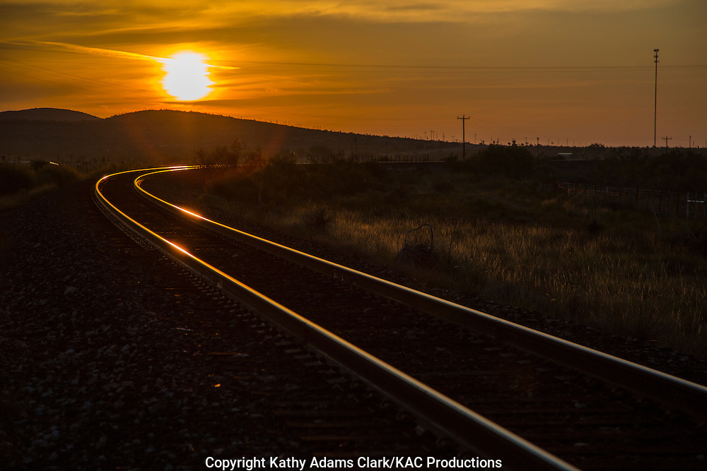 Railroad tracks reflect in the morning light in west Texas.