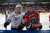 KELOWNA, CANADA - DECEMBER 7:  Kaid Oliver #34 of the Victoria Royals speaks to Lane Zablocki #27 of the Kelowna Rockets at the boards at centre ice on December 7, 2018 at Prospera Place in Kelowna, British Columbia, Canada.  (Photo by Marissa Baecker/Shoot the Breeze)