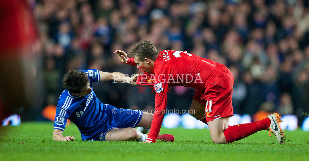 LONDON, ENGLAND - Sunday, December 29, 2013: Liverpool's Lucas Leiva clashes with Chelsea's Oscar dos Santos Emboaba Junior during the Premiership match at Stamford Bridge. (Pic by David Rawcliffe/Propaganda)