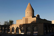 General view of Chashma-Ayub Mausoleum, 12th-16th century, Bukhara, Uzbekistan, pictured on July 11, 2010 in the afternoon. Chasma Ayub, or Spring of Job, commemorates the spot where  the prophet Job struck the dry earth with his staff and caused a spring to flow. The mausoleum consists of four domed chambers each topped with a different cupola, demonstrating the changing styles of architecture over the centuries of its construction. Bukhara, a city on the Silk Route is about 2500 years old. Its long history is displayed both through the impressive monuments and the overall town planning and architecture. Picture by Manuel Cohen.