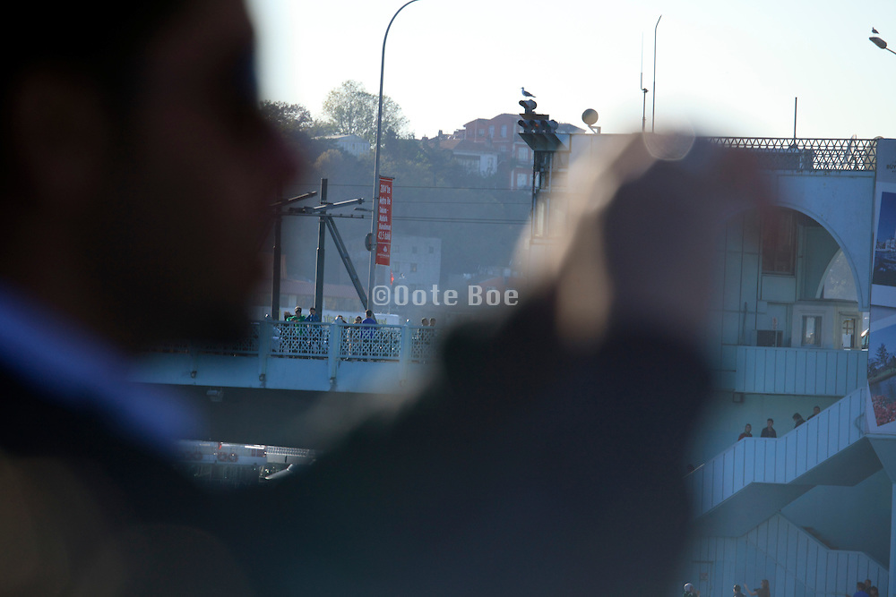 person photographing the Galata Bridge in Istanbul