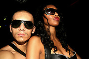 Two Hispanic looking people wearing sunglasses, Manumission, Ibiza 2006