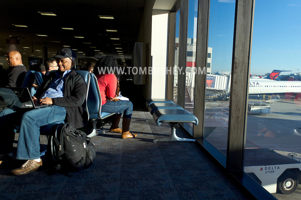 Atlanta, Georgia - A man uses a computer while waitng for a flight in the Delta terminal at Hartsfield-Jackson Atlanta International Airport on Feb. 3, 2013.