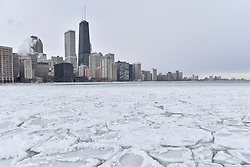 © Licensed to London News Pictures. 31/12/2017. CHICAGO, USA.  Pancake ice has formed in the waters of Lake Michigan around Chicago during a period of sub-zero temperatures.  Extremely cold conditions are forecast to continue into the New Year. Photo credit: Stephen Chung/LNP