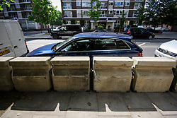 © Licensed to London News Pictures. 04/07/2017. London, UK. The barriers prevent drivers from being able to exit their cars on the pavement side. New security barriers which have been installed around Lord Cricket ground in St John's Wood, north London ahead of a cricket test match between England and South Africa which starts on Thursday (July 6th). The barriers run along a stretch of road already heavily lined with trees. Photo credit: Ben Cawthra/LNP