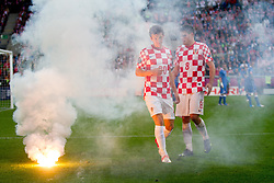 Flares and players Ivan Perisic of Croatia and Ognjen Vukojevic  of Croatia during the UEFA EURO 2012 group C match between Italy and Croatia at Poznan City Stadium on June 14, 2012 in Poznan, Poland.  (Photo by Vid Ponikvar / Sportida.com)