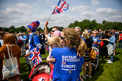 © Licensed to London News Pictures. 19/06/2016. London, UK. Emma Jelley holding her Two year-old Beatrice as they take part in 'The Big In' event at Hyde Park in London to promote an in vote at this week's EU membership referendum. Photo credit: Ben Cawthra/LNP