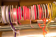 Rolls of ribbons in various colours and patterns reeady to beused to wrap gifts