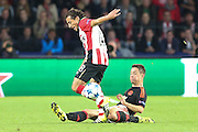 Ander Herrera of Manchester United tackles Andrés Guardado of PSV Eindhoven during the Champions League Group B match between PSV Eindhoven and Manchester United at Philips Stadion, Eindhoven, Netherlands on 15 September 2015. Photo by Phil Duncan.