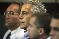 Jeffrey Epstein (center) is shown in a Palm Beach County courtroom on July 30, 2008, where he pleaded guilty to two prostitution charges.Handout Photo by Uma Sanghvi/Palm Beach Post/TNS/ABACAPRESS.COM