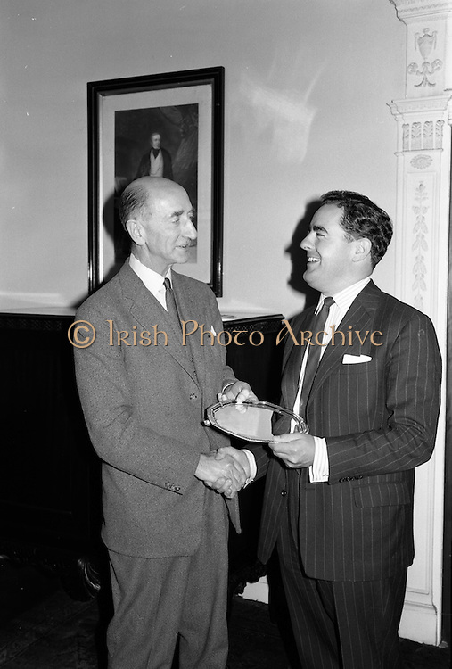 05/09/1962<br /> 09/05/1962<br /> 05 September 1962<br /> Presentation by Mr D. Dand (right) to member of staff at Gilbey's Wine Merchants, Nos. 46-49 O'Connell St., Dublin.