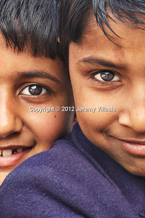 Close-up of a pair of school boys in Humayun's Tomb. New Delhi, India