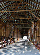 Honey Run Covered Bridge was built in 1894 on Butte Creek, halfway between Chico and Paradise in Butte County, California, USA. Pedestrians and bicycles can cross, but a damaging car crash in 1965 closed the bridge to auto traffic, which was rerouted to a steel bridge upstream. Chinook salmon and steelhead runs have been restored to Butte Creek, which flows 93 miles through a scenic volcanic canyon in Butte County.