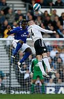 Photo: Steve Bond.<br />Derby County v Everton. The FA Barclays Premiership. 28/10/2007. Joseph Yobo (L) challanges Kenny Miller (R)