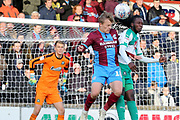 Scunthorpe United forward George Thomas (18) and Plymouth Argyll defender Tafari Moore (22) head the ball together during the EFL Sky Bet League 1 match between Scunthorpe United and Plymouth Argyle at Glanford Park, Scunthorpe, England on 27 October 2018. Pic Mick Atkins