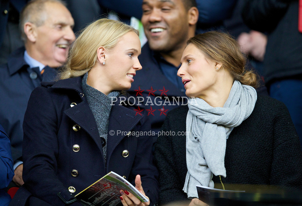 LIVERPOOL, ENGLAND - Saturday, October 26, 2013: Women's World Number 1 tennis player Caroline Wozniacki watches as Liverpool take on West Bromwich Albion during the Premiership match at Anfield. (Pic by David Rawcliffe/Propaganda)