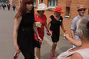Arriving ladies refuse to buy a flower posy during the annual Royal Ascot horseracing festival in Berkshire, England. Royal Ascot is one of Europe's most famous race meetings, and dates back to 1711. Queen Elizabeth and various members of the British Royal Family attend. Held every June, it's one of the main dates on the English sporting calendar and summer social season. Over 300,000 people make the annual visit to Berkshire during Royal Ascot week, making this Europe's best-attended race meeting with over £3m prize money to be won.