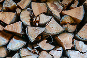 Stack of fire wood in a shed front view