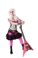 Portrait of beautiful young woman wearing wig standing with guitar over white background