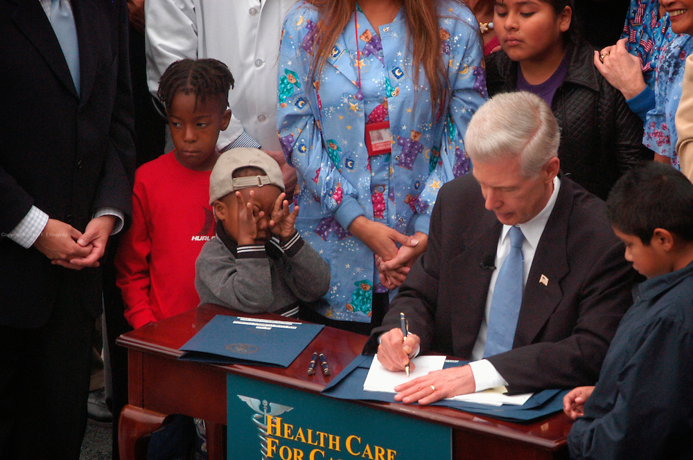 Los Angeles, CA, USA, Oct. 5th 2003: The Governor of California, Gray Davis, signs a new health care plan for California at the Kaiser Permanente Medical Center in West Los Angeles. Supporters of Gray Davis made a point of the Governor dealing with real politics and real life where there's no second take, referring to Arnold Schwarzenegger, who is running against Davis in the California Recall Election.<br /> <br /> <br /> <br /> Tyler (3) does some flirting with the cameras as he sits next to Mr. Davis<br /> <br /> <br /> <br />  *** Local Caption *** , posted on Corbis web ,