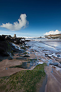 Waves lapping onto the beach at Watersmeet Bay near Woolacombe, North Devon, UK