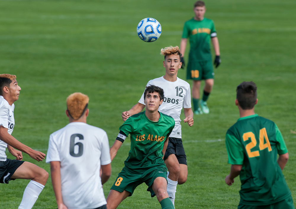 em110316q/jnorth/sports/From left, Los Alamos' Daniel Castano, #8, battles Chaparral High School's Kevin Alvarado, #12, during the State Tournament. The game was played in Bernalillo Thursday November 3, 2016.  Las Alamos won 1-0. (Eddie Moore/Albuquerque Journal
