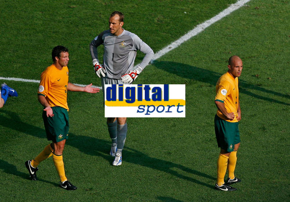 Photo: Glyn Thomas.<br />Italy v Australia. 2nd Round, FIFA World Cup 2006. 26/06/2006.<br /> Australia's Lucas Neill (L), Mark Schwarzer (C) and Marco Bresciano react in disbelief as a last-minute penalty is awarded against them.